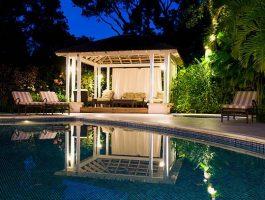 Gazebo and swimming pool at dusk.